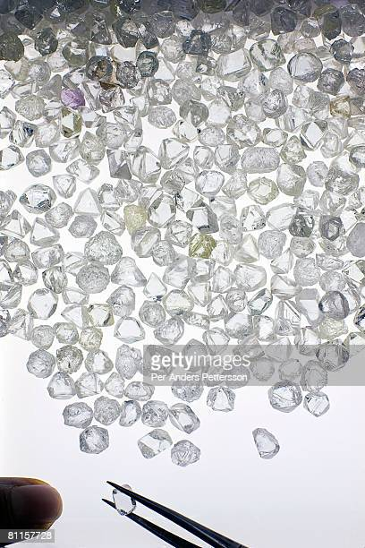 Raw diamonds are displayed on long tables as they are sorted at the new Diamond Trading Company the world's largest and most advanced diamondsorting...