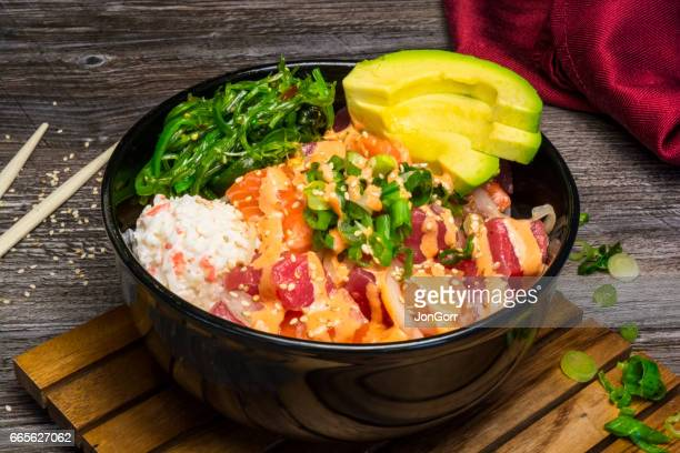 Raw Fish Sushi Pokebowl Meal With Red Napkin