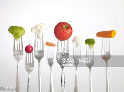 Raw Food on forks : Stock Photo