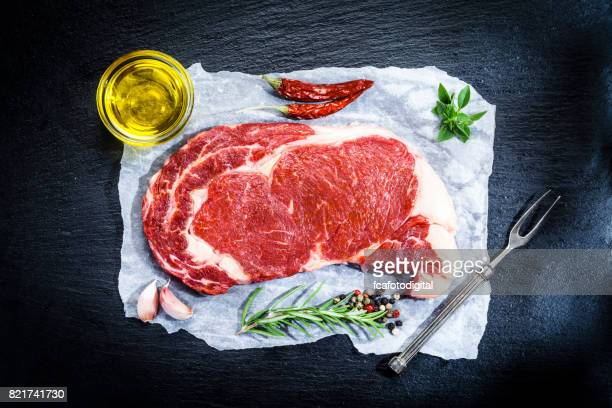 Raw fresh beef steak on dark background
