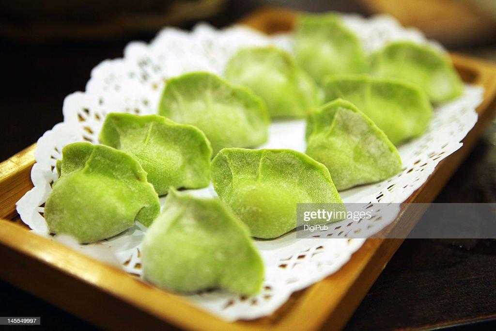 Raw green dumplings for hot pot : Stock Photo