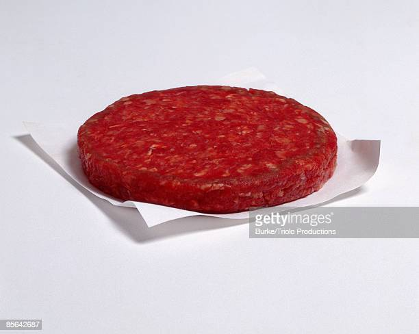 Raw hamburger patty