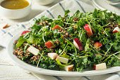 Raw Healthy Organic Kale and Apple Salad with Quinoa and Dressing