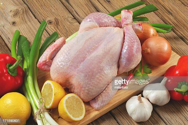 Raw hen with fresh vegetables