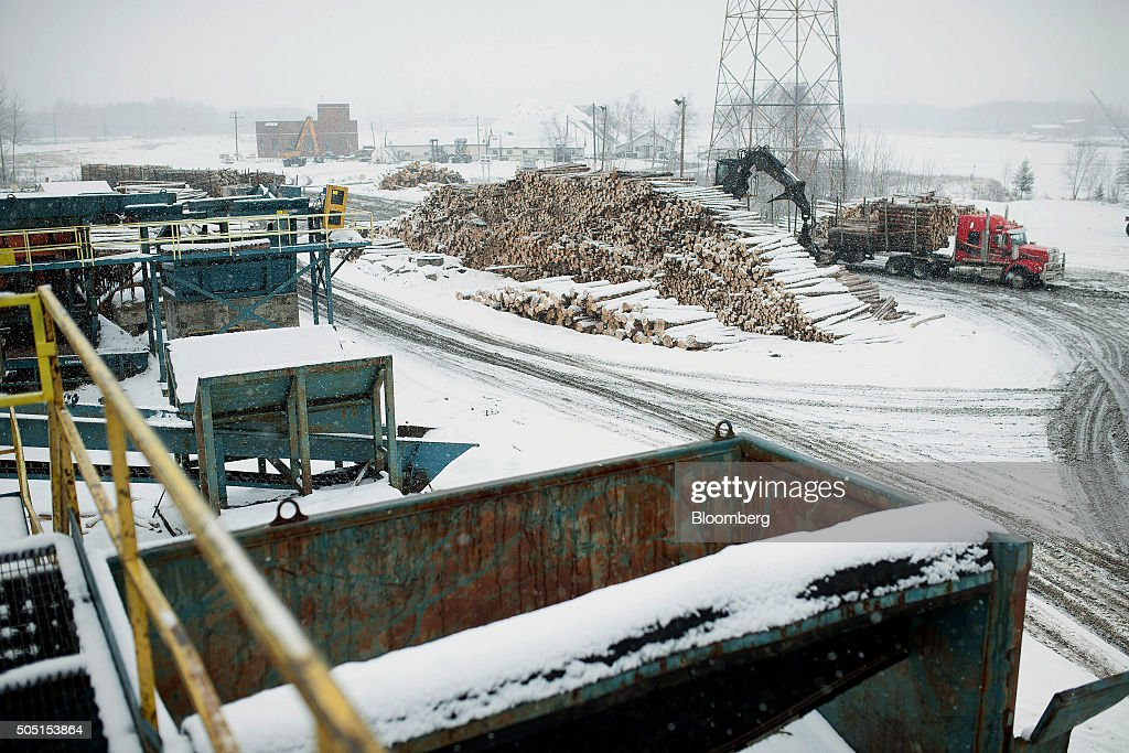Raw lumber is unloaded from a truck at the Resolute Forest Products mill in Thunder Bay Canada Ontario on Friday Jan 8 2016 Resolute Forest Products...