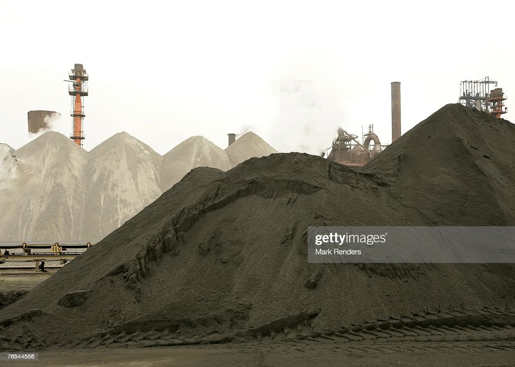 Raw material to produce steel is piled up at ArcelorMittal Gent on September 05 2007 in Ghent Belgium Following approval by the Extraordinary General...