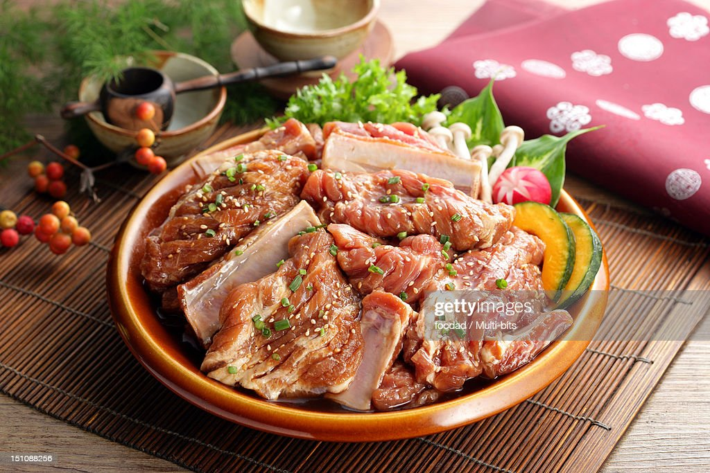 Raw meat with marinade : Stock Photo