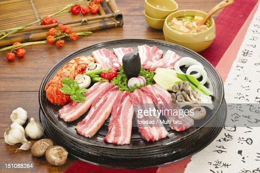 Raw meat with vegetables on the grill : Stock Photo