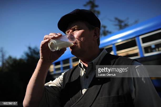 Raw milk crusader Michael Schmidt drank a glass of milk outside of his delivery bus in Vaughan Tuesday October 4 2011 Schmidt has started a hunger...