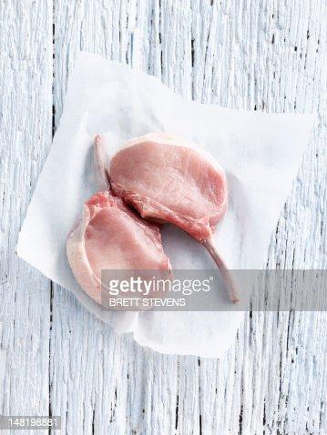 Raw pork chop in butcher paper