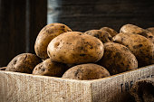 Heirloom potatoes in a wooden box, close up