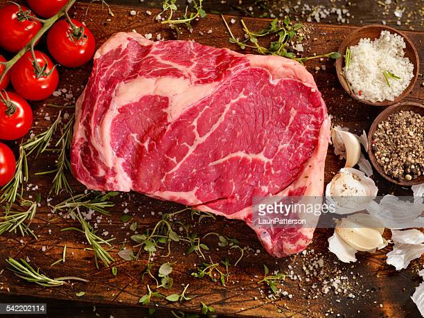 Raw Rib Eye Steak with Fresh Herbs