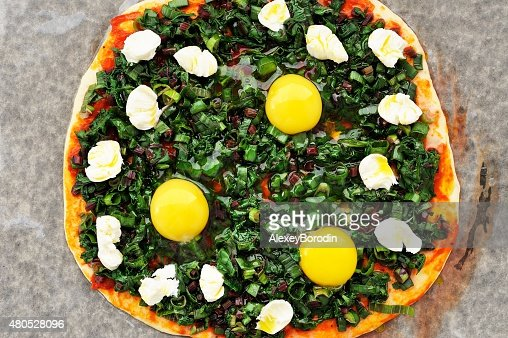 Raw round green pizza with chard, eggs and mozarella : Stock Photo