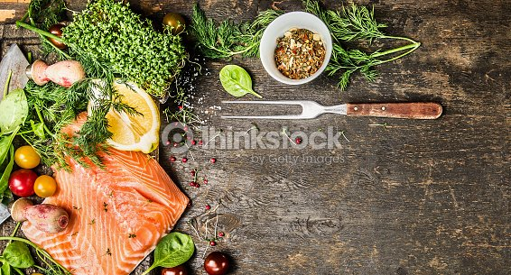 Raw Salmon Fillet With Fresh Seasoning On Rustic Background Banner Stock Photo
