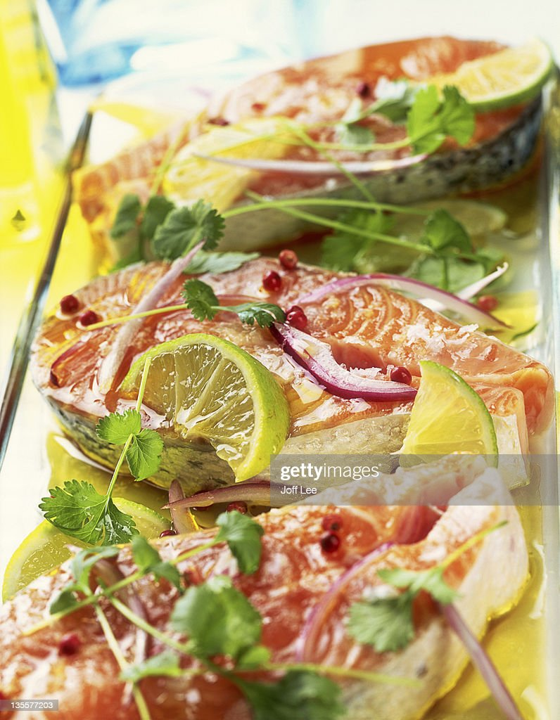 Raw salmon steaks marinated in olive oil : Stock Photo