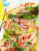 Raw salmon steaks marinated in olive oil