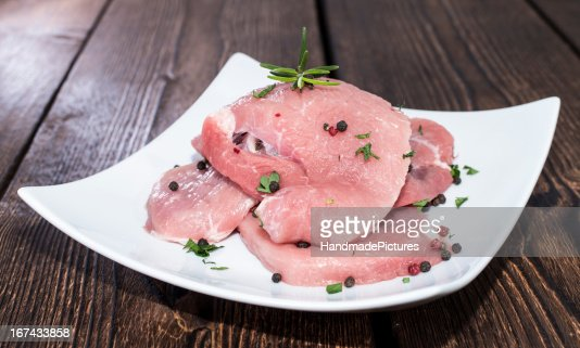 Raw Schnitzel on a plate : Stock Photo