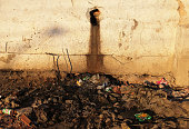 Raw sewage drains from an occupied building in the Mangueira 'favela' community on July 12 2016 in Rio de Janeiro Brazil Much of the Mangueira favela...