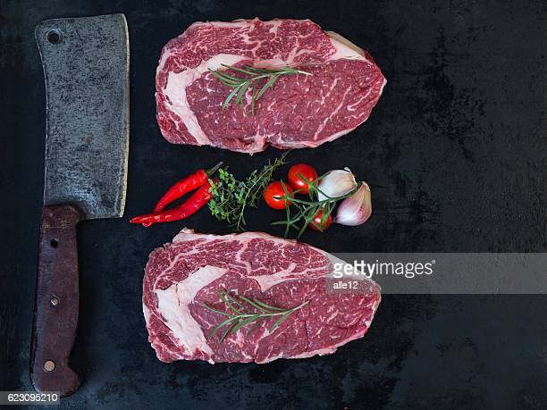Raw stek with cleaver