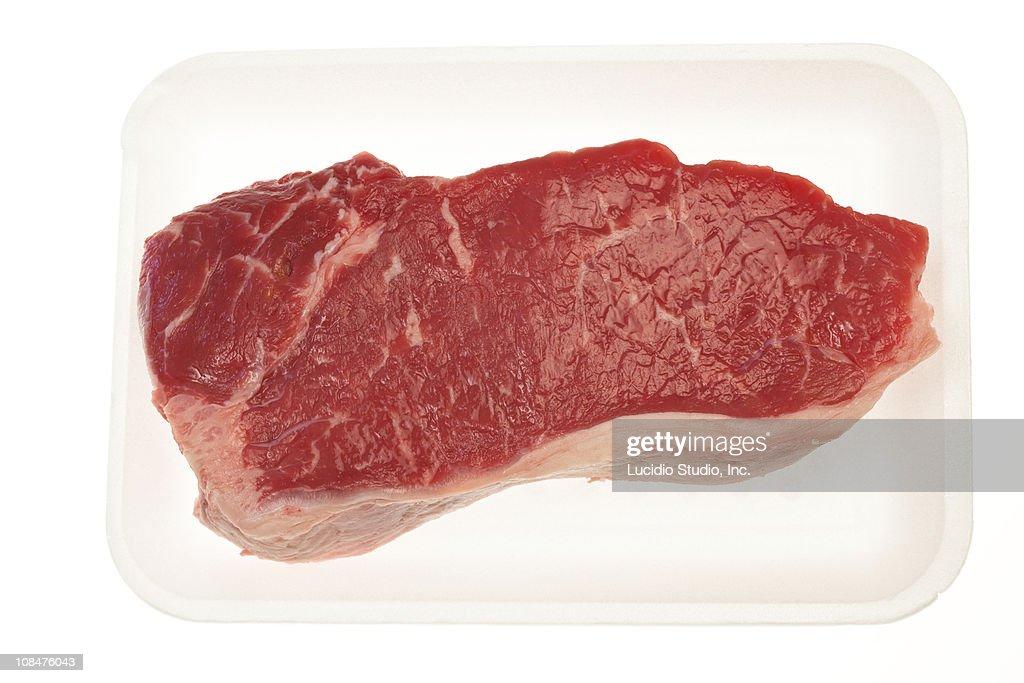 Raw striploin steak isolated on white