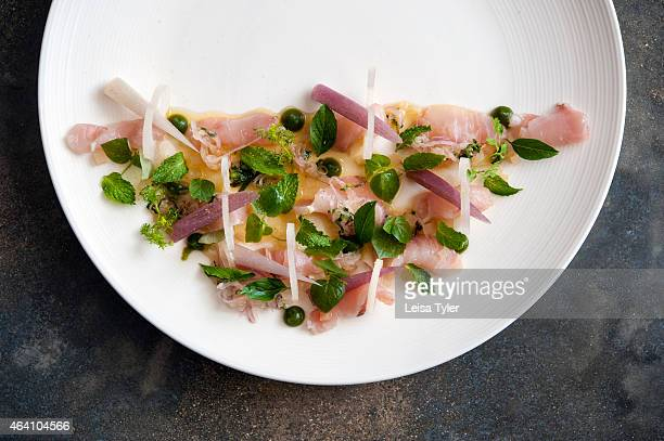 Raw tuna with lily flower stem banana heart salted turnip and hot basil at the Common Tiger the restaurant of South African chef Timothy Bruyns in...