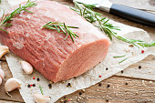 Fresh and raw meat. Whole piece of Sirloin veal steaks ready to cook on rustic wooden table