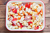 Raw vegetables and turkey fillet in the form, cooked for roasting, top view, horizontal