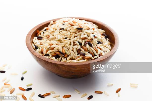 Raw wild brown rice blend on a wooden bowl