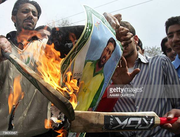 Pakistani students burn a poster of Pakistani cricket team captain InzamamulHaq and cricket bats during a demonstration in Rawalpindi 19 March 2007...