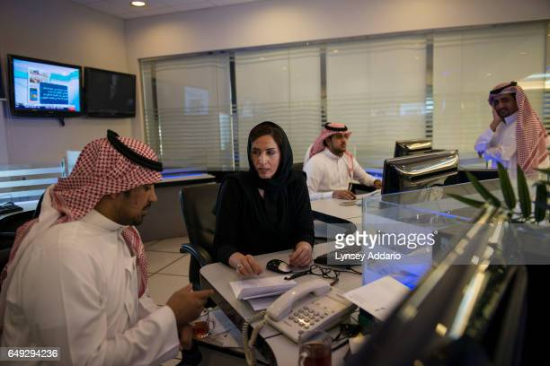 Rawda al Jazani a Saudi TV producer discusses stories with colleagues in the studio at the Ministry of Information in Riyadh Saudi Arabia Feb 27 2013...