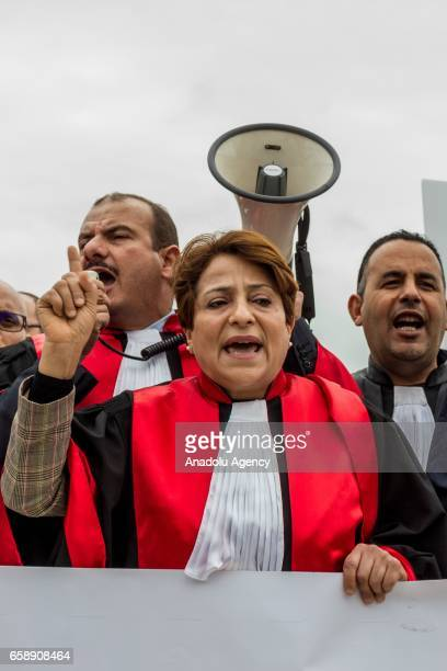 Rawda Kharafi president of the Tunisian Judges Association attends a demonstration protesting higher judicial commission resolution that proposed to...