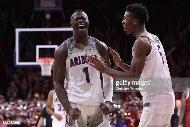 Rawle Alkins and Brandon Randolph of the Arizona Wildcats celebrate after defeating the Alabama Crimson Tide in the college basketball game at McKale...