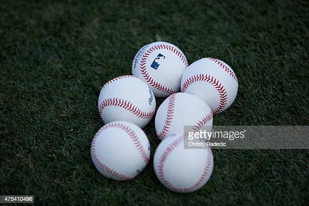 Rawlings baseballs with the MLB Logo lie on the field before the Los Angeles Angels of Anaheim home opener against the Kansas City Royals at Angel...