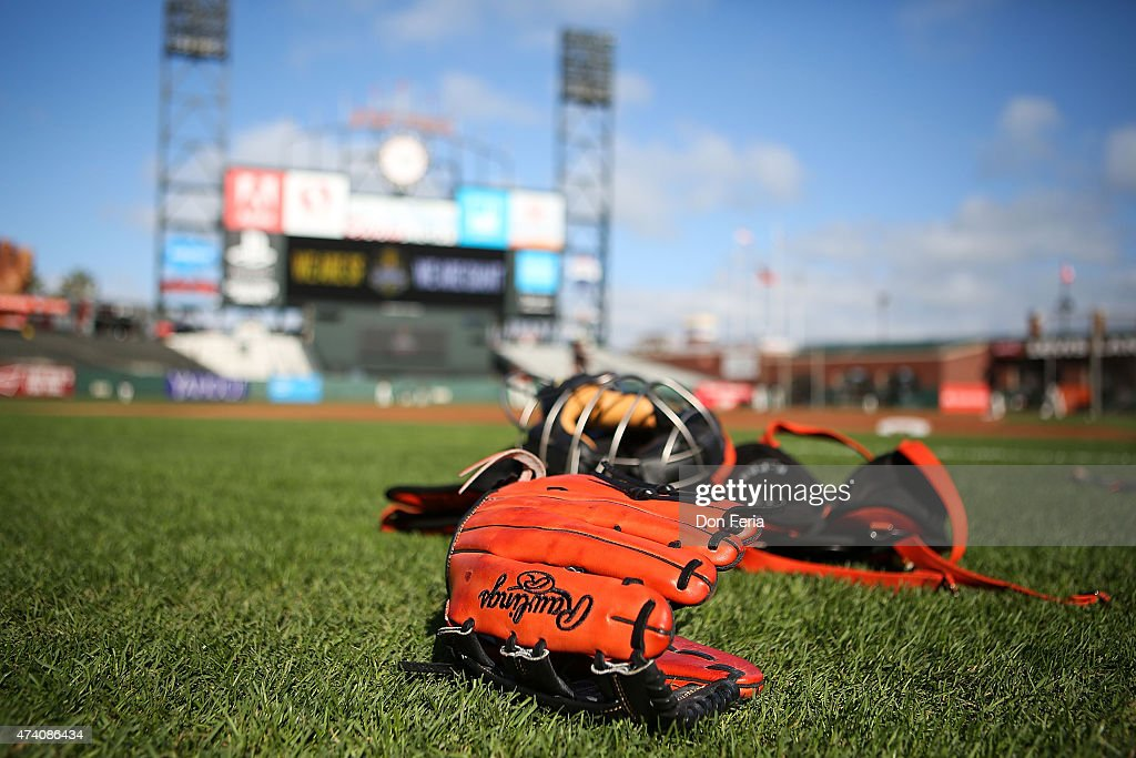 Rawlings glove is placed on the infield grass before competition between the San Francisco Giants and the visiting Los Angeles Dodgers at ATT Park on...
