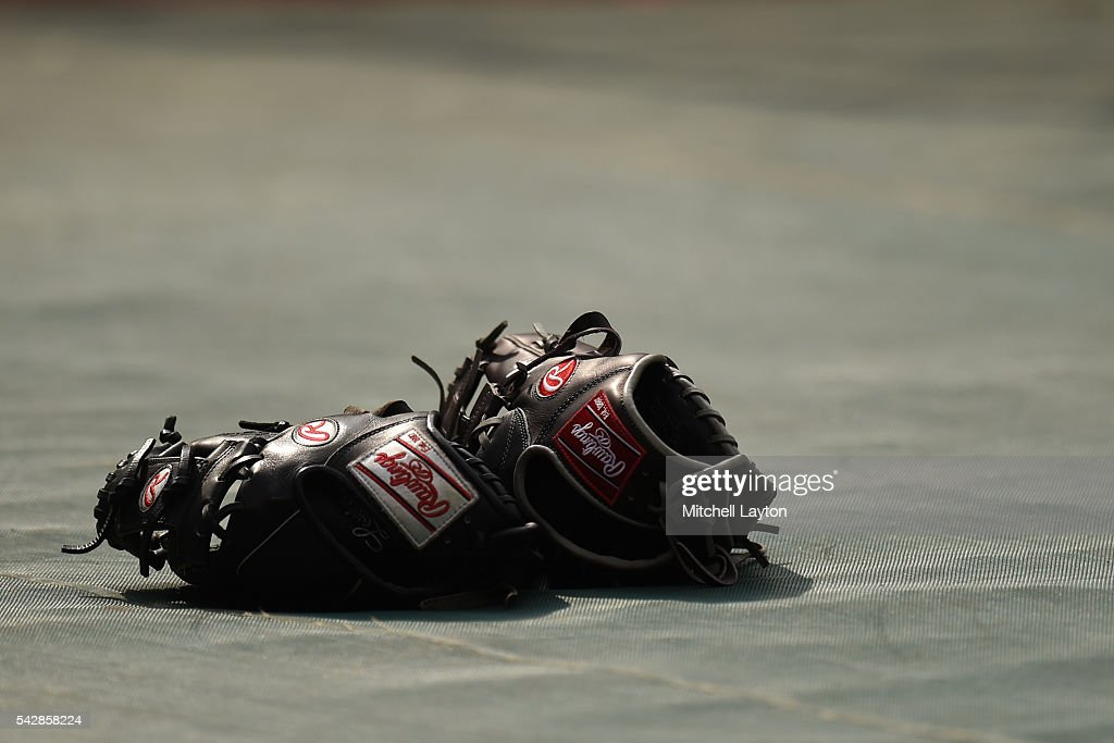 Rawlings gloves on the field before a baseball game between the Baltimore Orioles and the Tampa Bay Rays at Oriole Park at Camden Yards on June 24, 2016 in Baltimore, Maryland.