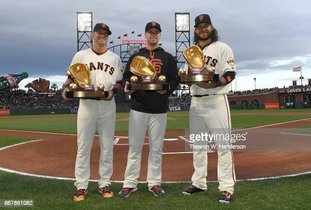 Rawlings Gold Glove winners Joe Panik Buster Posey and Brandon Crawford of the San Francisco Giants pose together after receiving their trophies...