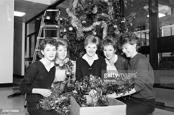 Rawthorpe High School pupils decorating the Christmas Tree in the entrance to St Luke's hospital Crosland Moor 21st December 1985