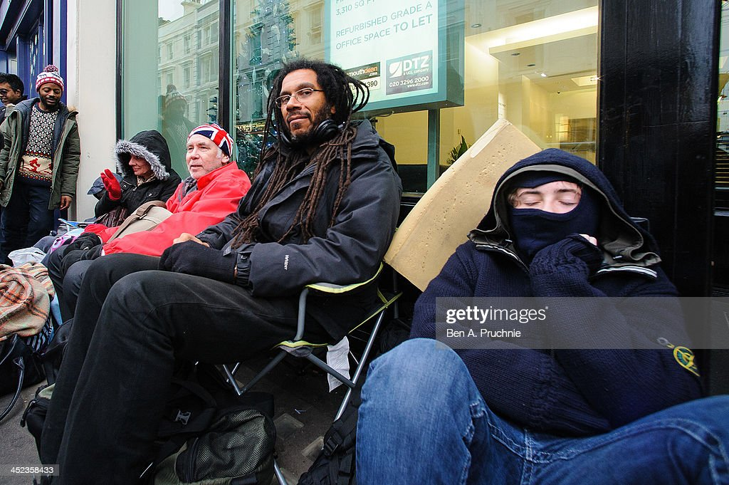 Ray, 45, a gamer who has queued in Covent Garden ahead of the launch of the Playstation 4 since 6am on November 28, 2013 in London, England. , Photo by Ben A. Pruchnie/Getty Images)