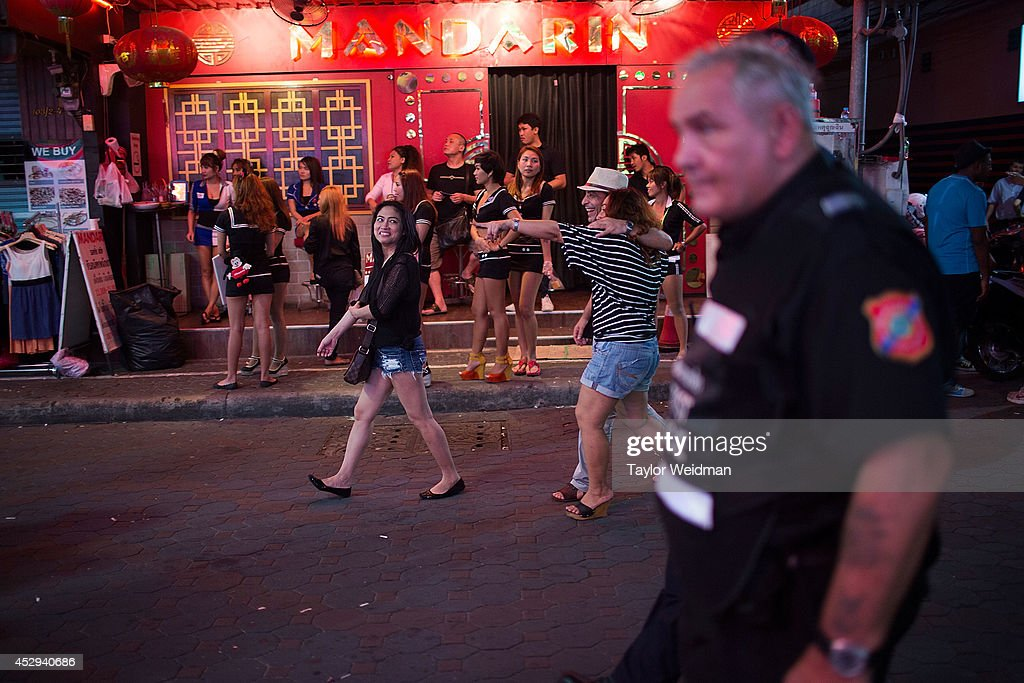 Ray Aldridge, Senior Team Leader, patrols Pattaya's walking street on July 31, 2014 in Pattaya, Thailand. Since 2002, members of the Foreign Tourist Police Assistants (FTPA) of Pattaya have been assisting local police on Walking Street, Pattaya's main nightlife area. Members of the FTPA carry handcuffs, batons, and pepper spray, and are charged primarily with assisting foreign visitors and the Thai police, as well as breaking up fights and catching thieves.