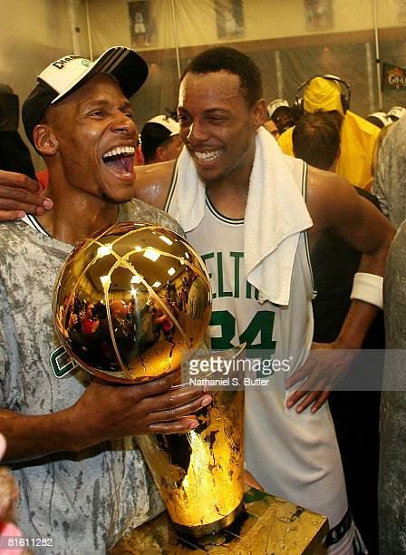 Ray Allen and Paul Pierce of the Boston Celtics hold the Larry O'Brien trophy while celebrating after the defeat of the Los Angeles Lakers in Game...
