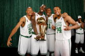 Ray Allen Kevin Garnett James Posey and Paul Pierce of the Boston Celtics pose for a portrait with the Larry O'Brien trophy after defeating the Los...