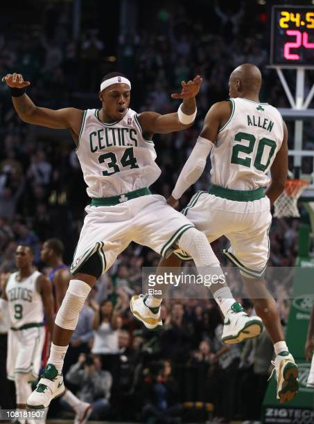 Ray Allen of the Boston Celtics celebrates his game winning shot with teammate Paul Pierce during the final seconds of the game against the Detroit...