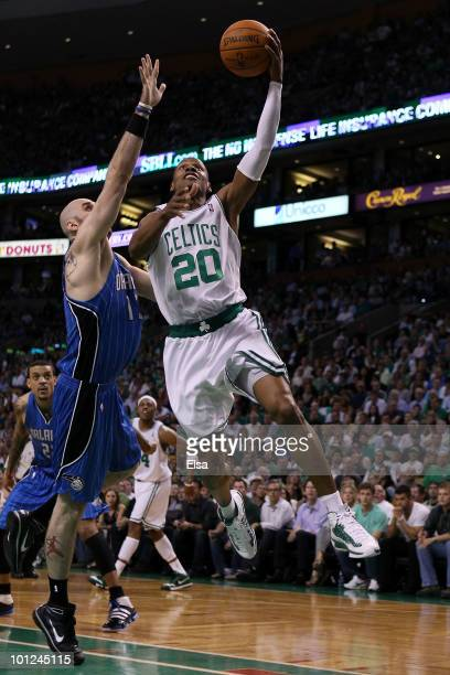 Ray Allen of the Boston Celtics drives for a shot attempt against Marcin Gortat of the Orlando Magic in Game Six of the Eastern Conference Finals...