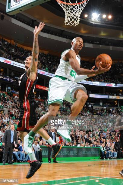 Ray Allen of the Boston Celtics goes up for the reverse layup against Michael Beasley of the Miami Heat in Game Five of the Eastern Conference...