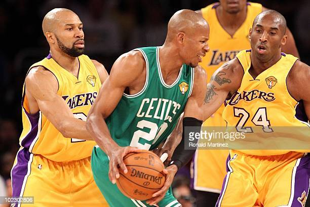 Ray Allen of the Boston Celtics looks to move the ball as he is covered by Derek Fisher and Kobe Bryant of the Los Angeles Lakers in the first...