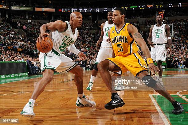 Ray Allen of the Boston Celtics looks to shoot against Brandon Rush of the Indiana Pacers on March 12 2010 at the TD Garden in Boston Massachusetts...