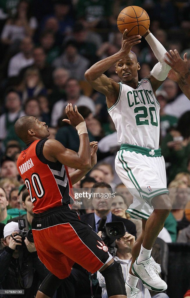 Ray Allen #20 of the Boston Celtics passes the ball as Leandro Barbosa #20 of the Toronto Raptors defends on January 7, 2011 at the TD Garden in Boston, Massachusetts. The Celtics defeated the Raptors 122-102.