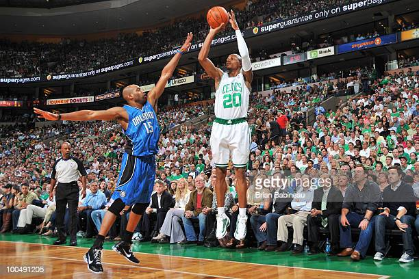 Ray Allen of the Boston Celtics puts up a three point shot against Vince Carter of the Orlando Magic in Game Four of the Eastern Conference Finals...