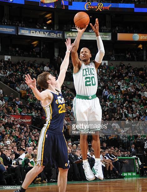 Ray Allen of the Boston Celtics shoots against Gordon Hayward of the Utah Jazz on January 21 2011 at the TD Garden in Boston Massachusetts NOTE TO...