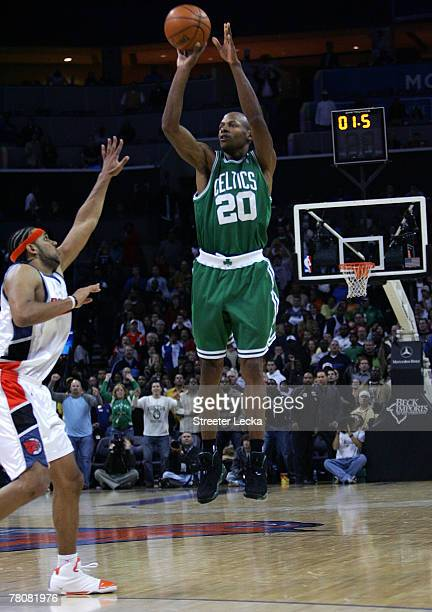 Ray Allen of the Boston Celtics shoots the gamewinning shot as time expires over Jared Dudley of the Charlotte Bobcats at Charlotte Bobcats Arena on...